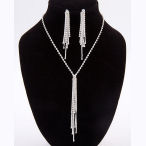 This silvertone and clear rhinestone tassel 13.38in necklace with 4in ext and 4.5in drop and 3in earrings
