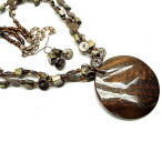 Big and brown with lots of shine this 18 inch necklace with 2 inch drop and earring set is a must have