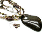 Big is beautiful with this brown and gold lucite 20 inch necklace with 3 inch chunky drop and earrings