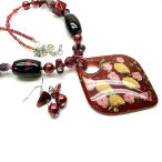 This red and gold  necklace set is big and beautiful 20 inch long with 3 inch drop