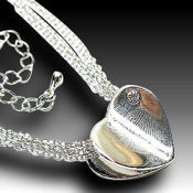 Multi strand Polished silver heart with an AAA CZ