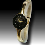 Armitron stylish gold band with a black provocative face with a diamond  $45
