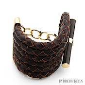 8250 $115 Dyrberg-Kern Maelee collection Brown leather and Gold plate 104g, 54mm wide 8mm high Toggle clasp MSRP $439