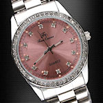 Girl's pink, Classic pink crystal quartz by Free Crane watches, 3.5cm case size 0.8cm thick 1.6cm wide, adjustable band with a 1 year MFG warranty.